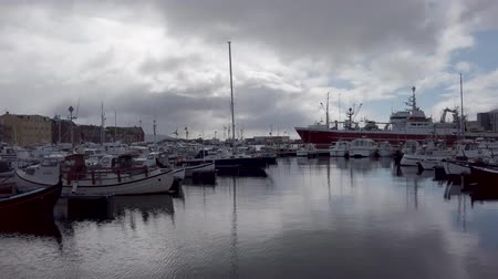 Torshavn, Faroe Islands - August 2019: Fishing boats in Torshavn marina harbour on Faroe islands.