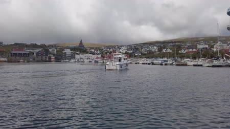 Torshavn, Faroe Islands - August 2019: A boat sailing into Torshavn marina harbour on Faroe islands. Stock Footage