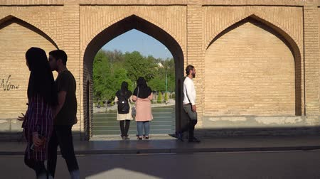 isfahan : Isfahan, Iran - May 2019: Iranian people on SioSePol or Bridge of 33 arches, one of the oldest bridges of Isfahan