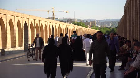 Isfahan, Iran - May 2019: Iranian people on SioSePol or Bridge of 33 arches, one of the oldest bridges of Isfahan