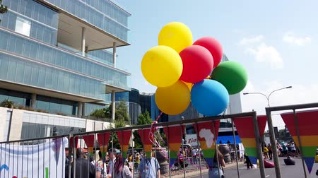 gururlu : Johannesburg, South Africa - October 2019: Colorful balloons in South Africa gay pride march Stok Video