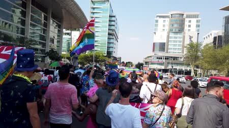 Johannesburg, South Africa - October 2019: Crowded people marching and having fun at Gay pride March Stock Footage