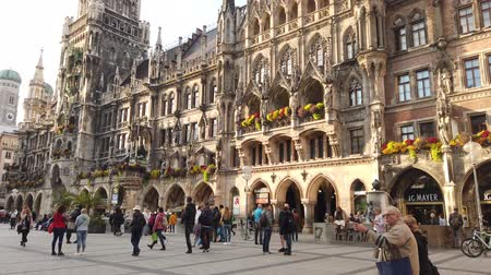 Munich, Germany - October 2019: Munich Marienplatz square with tourists and local german people visiting Стоковые видеозаписи