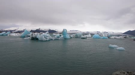 jokulsarlon : View of icebergs in Jokulsarlon glacier lagoon formed with melting ice, Iceland, global warming and climate change concept Stock Footage