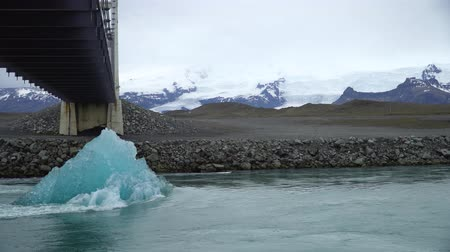 iceberg : Melting ice block floating towards the ocean in Jokulsarlon glacier lagoon, Iceland. Global warming and climate change concept