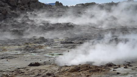 geiser : Hverir Myvatn geothermal area with natural steam vents and mud pools all around Lake Myvatn, the Hverir geothermal fields, Iceland Stockvideo