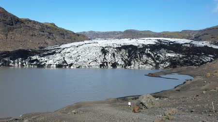 snow caps : Solheimajokull outlet glacier and the glacial lagoon, Solheimajokull, Iceland