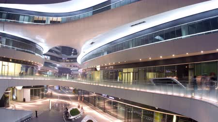 Пекин : Beijing, China – July 7th, 2014: Timelapse view in Galaxy Soho at night, some people playing in it.4K Стоковые видеозаписи