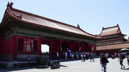 drágakő :  Beijing, China – June 27th, 2014: the view of Treasure gallery in Forbidden at daytime, there are many tourists in it. Stock mozgókép