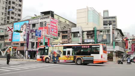 polinésia : Taipei Taiwan ROC February 09 2015: Street Scene at the East Gate Business Area in the Daytime You can See the 101 Tower in the Distance. Stock Footage