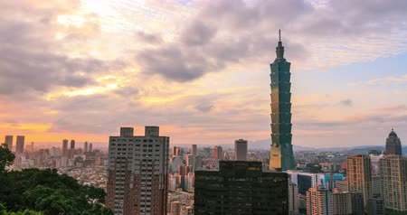 sunset city : Timelapse view of 101 Tower at sunset with Taipei city, seeing from elephant mountain. Stock Footage