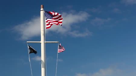 usa independence day : American flags waving in the wind on the typical American flagpole before a blue sky
