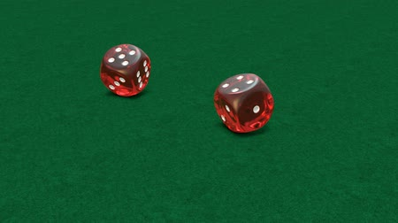 Slow motion of rolling red dice on green background, close up and six number 6-6 Stock mozgókép