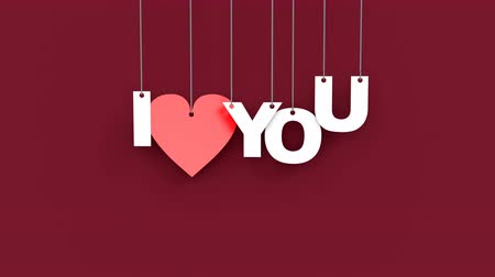 vinheta : Beautiful 3D animation of heart with text I love you. Hanging on the ropes cardboard text falls from top to bottom on an purple background