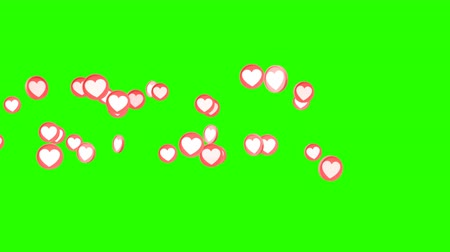 luty : Social love hearts icon animation can be used to make a Declaration of love on Valentines Day. Animation from left to right on green background. Wideo