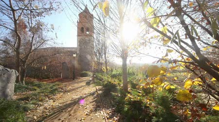 Hermitage, chapel or church.Village and nature landscape.Scenery autumn and church.Rural park village sunset Стоковые видеозаписи