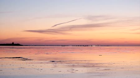 serenity : Sunset in Ria Formosa natural conservation region whit Cabo de Santa Maria Lighthouse (Farol island) in the background, Algarve, Portugal. Stock Footage