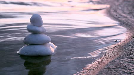 natural tranquil : Stack of round smooth marble stones in Zen style and sea waves background