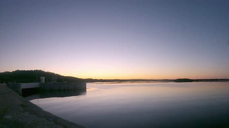 baraj : Twilight in Alqueva Dam lake. It impounds the River Guadiana, on the border of Beja and Évora Districts in south of Portugal and constitutes one of the largest dams and artificial lakes (250 km²) in Western Europe.