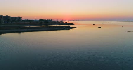 dockyard : Sunrise aerial seascape view of Olhao waterfront to Ria Formosa natural park. Algarve. Portugal. Stock Footage