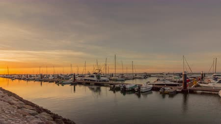 dockyard : Sunrise pan timelapse seascape view of Olhao Marina, waterfront to Ria Formosa natural park. Algarve. Portugal. Stock Footage