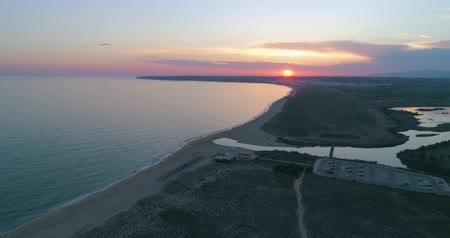 dune : Aerial sunset seascape of Salgados beach in Albufeira, Algarve tourism destination region, Portugal. Stock Footage