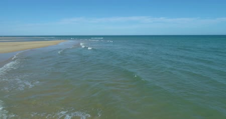 marine park : Aerial seascape of Fuseta beach and inlet in Ria Formosa wetlands, Algarve tourism destination region, Portugal. Stock Footage