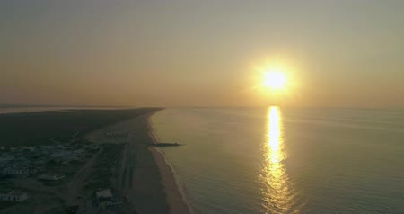 teszi : Aerial sunrise view of beautiful ilha do Farol (lighthouse island), in Ria Formosa famous nature destination, Algarve coast, Portugal. gal. Stock mozgókép