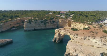 arch rock : Aerial seascape in Praia Albandeira, popular beach destination of Algarve barlavento rocky cliff coast. South Portugal. Stock Footage