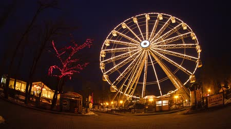 rodas : Kaliningrad, Russia, March 02 2013: Ferris wheel at night time, time lapse Stock Footage