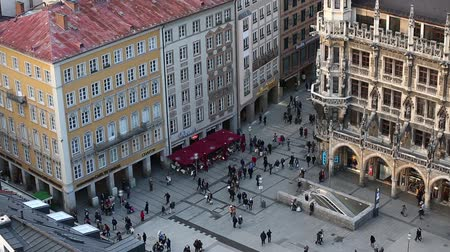 munique : Munich, Germany - January 04, 2016: People walking on the Marienplatz nearby the City Hall, view from tower of St.Peter Church, the central famous place of the city, evening time