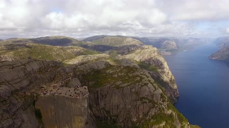 Large group of tourists on the Pulpit Rock in Norway in summer, aerial view