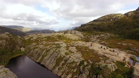 Tourists are hiking to the Pulpit Rock in Norway, summertime