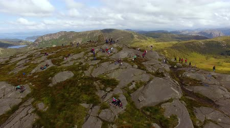 Tourists are resting on the top of the Dalsnuten mountain in Norway, aerial view Stock Footage