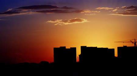 sustain : Hot Sunset Over Industrial Buildings. A great piece of stock in 4k definition, perfect for film, tv, documentaries, reality TV, trailers, infomercials and more!