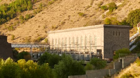 sustain : Hydropower Station on the Hillside. A great piece of stock in 4k definition, perfect for film, tv, documentaries, reality TV, trailers, infomercials and more!
