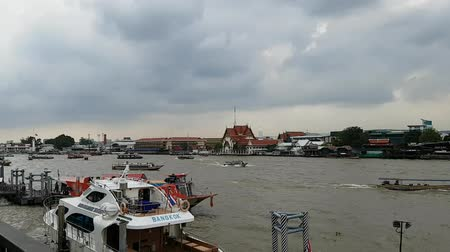 phraya : View of the city Bangkok in Thailand Republic with colorful paddle boats day to evening transition time lapse on the Chao Phraya river with beautiful sky, Busy Transportation System. Stock Footage