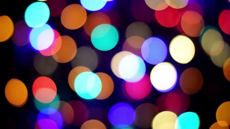 changing lights : Bokeh background, multi colored blurred flickering Christmas fairy lights at night.