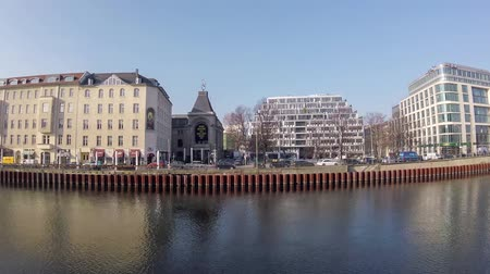 pitka : BERLIN, GERMANY - FEBRUARY 7, 2018: Time Lapse: River Spree At Schiffbauerdamm With The Theatre of The Berliner Ensemble In Background