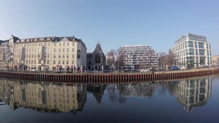 pitka : BERLIN, GERMANY - FEBRUARY 7, 2018: River Spree At Schiffbauerdamm With The Theatre of The Berliner Ensemble In Background Dostupné videozáznamy