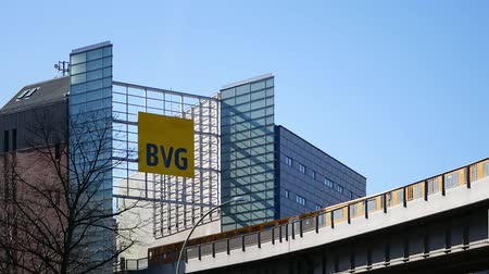 idari : BERLIN, GERMANY - APRIL 8, 2018: Administration Building of BVG, German for Berlin Transport Company, With BVG Logo And Train