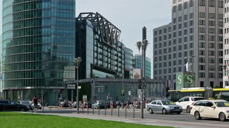 pan shot : BERLIN, GERMANY - APRIL 22, 2018: Time Lapse Pan Shot: Traffic At Potsdamer Platz In Berlin, Germany, With Skyscrapers Stock Footage