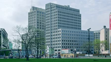 busz : BERLIN, GERMANY - APRIL 22, 2018: Time Lapse Zoom: Traffic At Potsdamer Platz In Berlin, Germany, With Skyscrapers Stock mozgókép