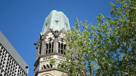 breitscheidplatz : BERLIN, GERMANY - APRIL 30, 2018: Famous Kaiser Wilhelm Memorial Church Against A Blue Sky In Berlin, Germany