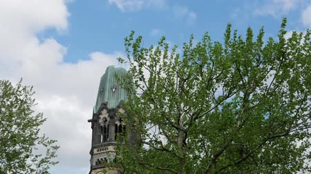 breitscheidplatz : Time Lapse: Famous Kaiser Wilhelm Memorial Church Against A Cloudy Sky In Berlin, Germany
