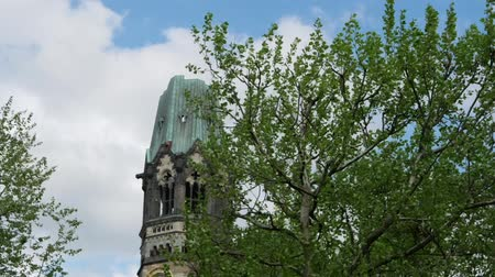 breitscheidplatz : Time Lapse Pan Shot: Famous Kaiser Wilhelm Memorial Church Against A Cloudy Sky In Berlin, Germany Stock Footage