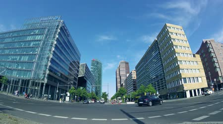 fish eye : BERLIN, GERMANY - MAY 19, 2018: Fish-Eye Time Lapse: Traffic Near Potsdamer Platz In Berlin, Germany, Skyscrapers In The Background