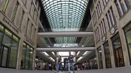 passerby : BERLIN, GERMANY - MAY 30, 2018: Fish-Eye Time Lapse Zoom Out: At The Entrance of Famous Shopping Mall Called LP12 Mall of Berlin In Berlin, Germany