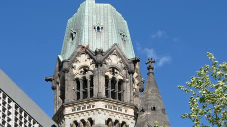 breitscheidplatz : BERLIN, GERMANY - APRIL 30, 2018: Pan Shot: Famous Kaiser Wilhelm Memorial Church Against A Blue Sky In Berlin, Germany Stock Footage