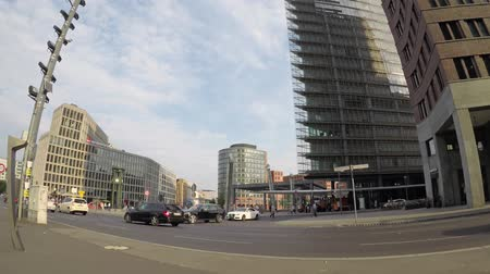 fish eye : BERLIN, GERMANY - JUNE 16, 2018: Time Lapse: Traffic And Tourists At Potsdamer Platz In Berlin, Germany